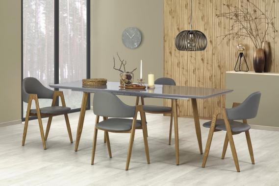 Roten rozkladací jedálenský stôl v modernom dizajne